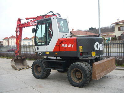 Re: Kolový bagr New Holland MH city